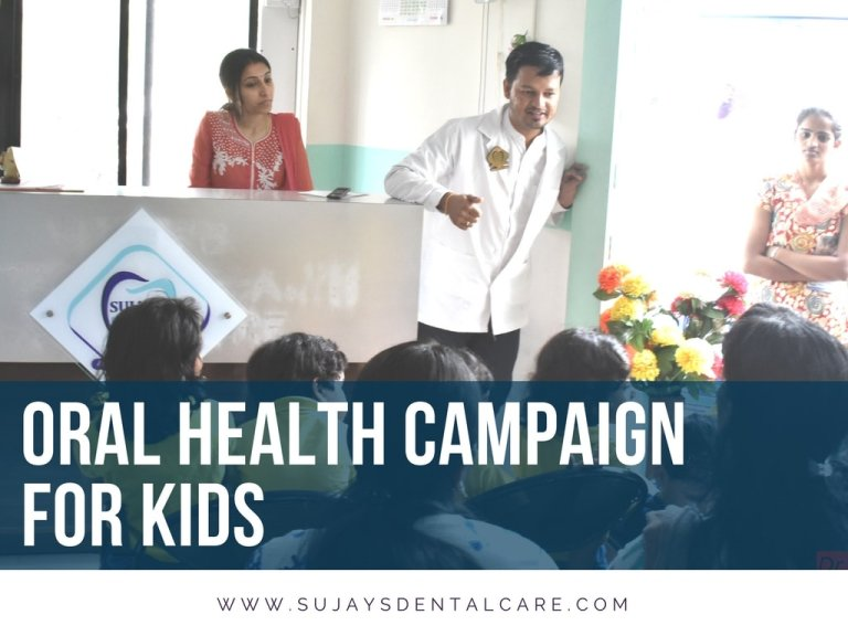 Dr. Sujay Gopal speaking to kids of Kidzee during a dental campaign event