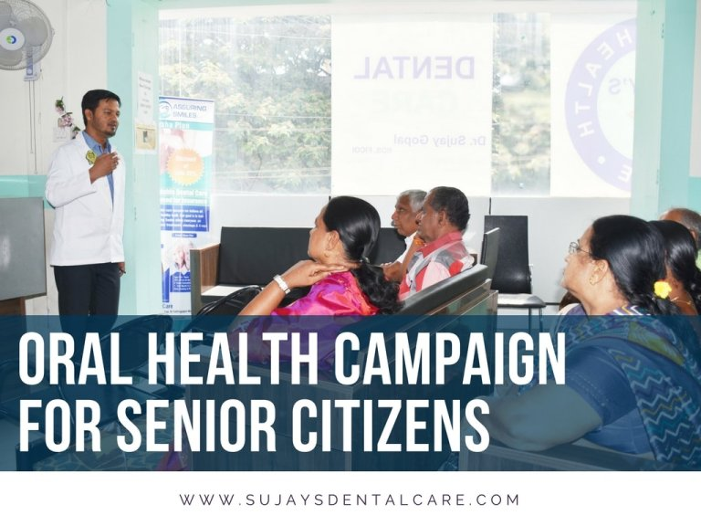 Dr. Sujay Gopal speaking to senior citizens of kathriguppe during a dental campaign event