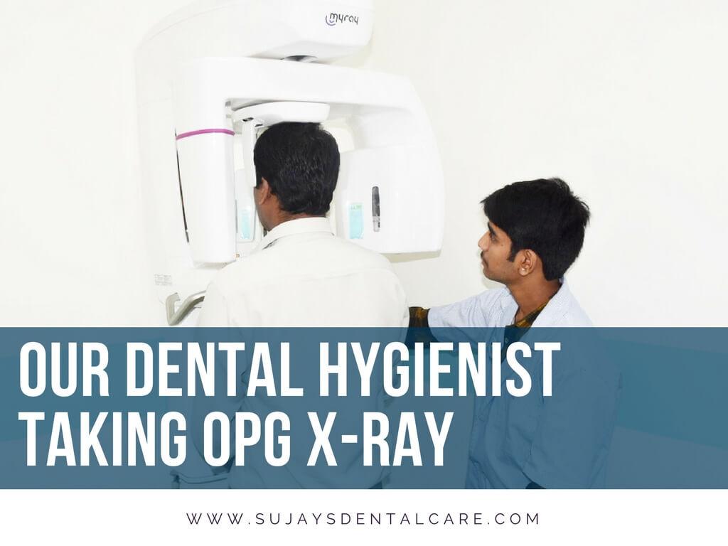 Dental hygenist taking a OPG x-ray of a patient